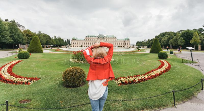 Female traveler on the background of Belvedere Palace complex of the 18th century in Vienna, Austria. royalty free stock images