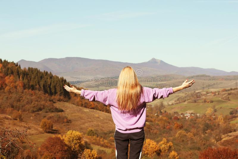 Female traveler feeling free in mountains royalty free stock photography