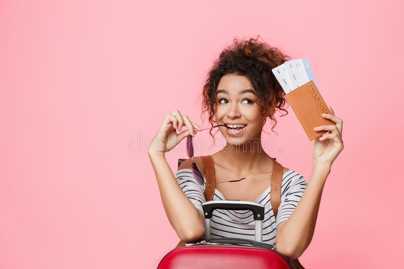 Female traveler with passport and ticket dreaming about trip stock photography