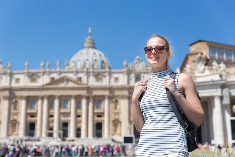 Woman on St. Peter`s Square in Vatican in front of St. Peter`s Basilica. Female traveler on St. Peter`s Square in Vatican in front of St. Peter`s Basilica royalty free stock photo