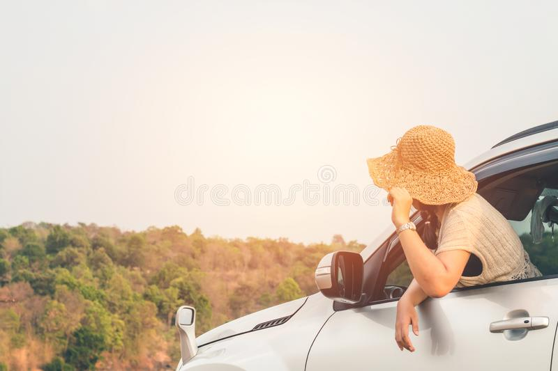Female travelers travel with cars in the midst of peaceful nature, Traveling of tourists only to find the beauty of nature royalty free stock images