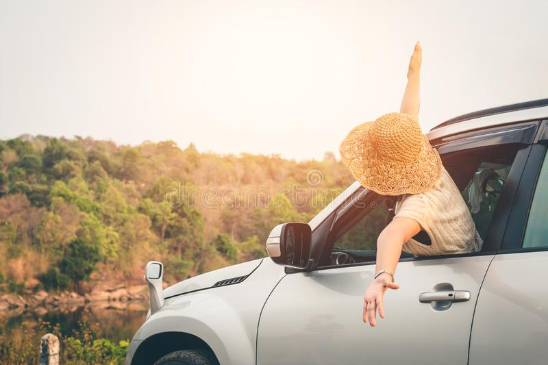 Female travelers travel with cars in the midst of peaceful nature, Traveling of tourists only to find the beauty of nature stock images
