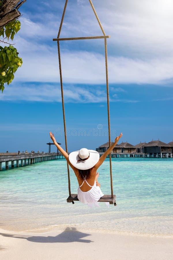 Female traveller enjoys her tropical summer vacation stock photos