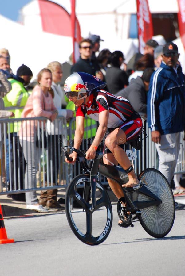 Female triathlete cycling royalty free stock image