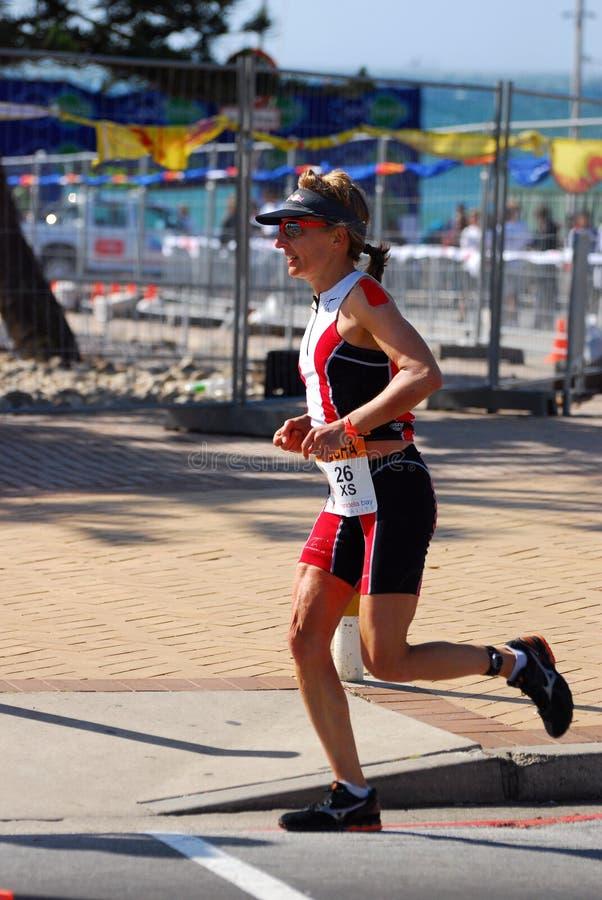 Female triathlete running royalty free stock images
