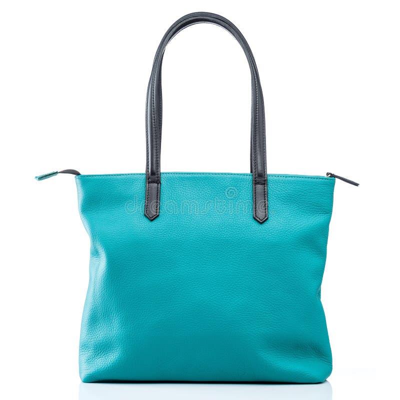 Female turquoise leather handbag stock photography