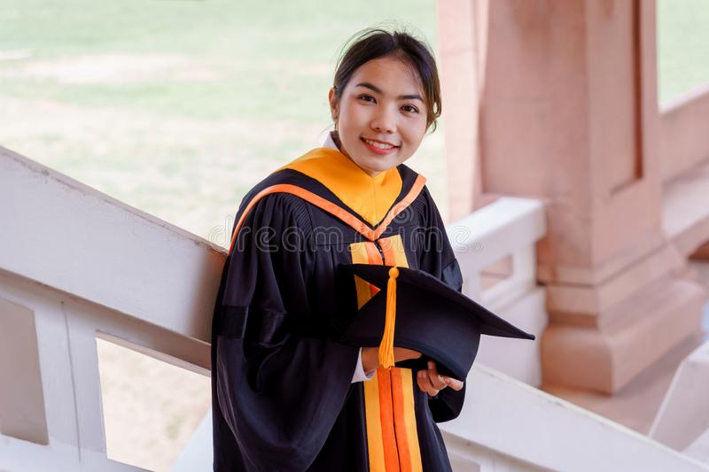 Female university graduates celebrate happily after completed and received diploma degree certificate in commencement ceremony. Th. E woman graduate express royalty free stock photo