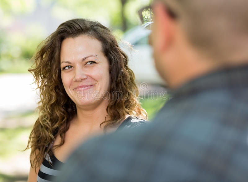 Female University Student Looking At Male Friend stock photography