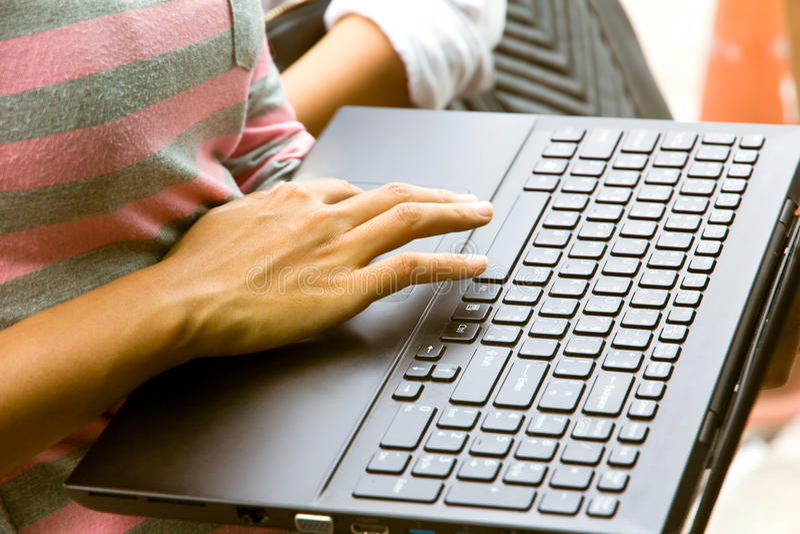 Female using laptop stock photo