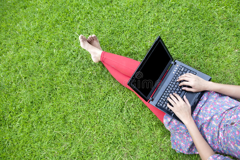 Download Female Using Laptop Outdoor Stock Image - Image: 24796459
