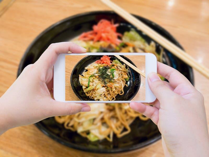 Taking photo of Yakisoba, japanese fried noodle royalty free stock photo