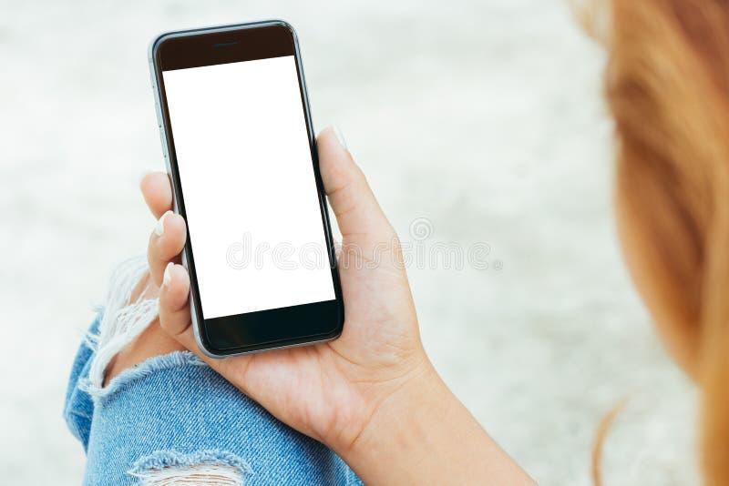 Female using phone white screen display. Closeup female using phone white screen display stock photography