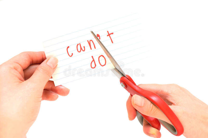Female using scissors to remove the word can't to read I can do royalty free stock photo