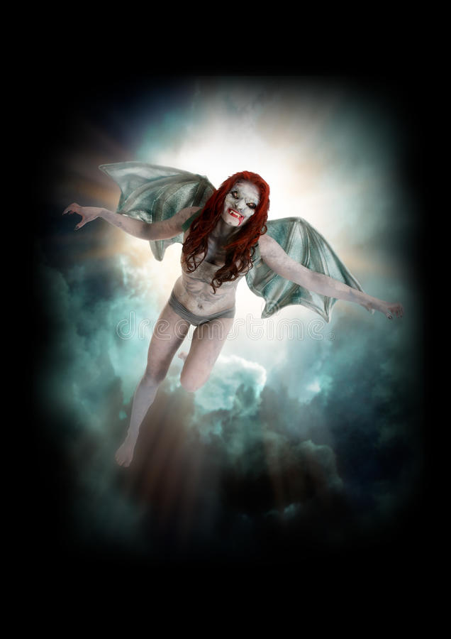 Female vampire like creature flying. Female vampire like like creature flying through the night sky hands out streched in a fun but scary fashion stock photography