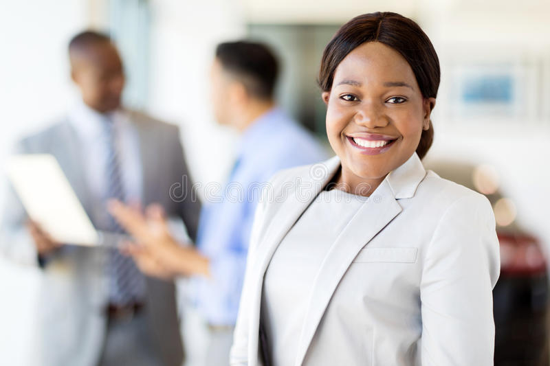 Female vehicle sales consultant royalty free stock image