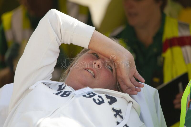 An injured victim of an explosion lies on a stretcher at