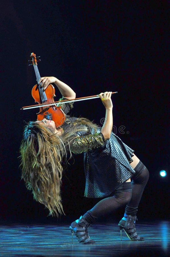 Female virtuoso violin player royalty free stock photos