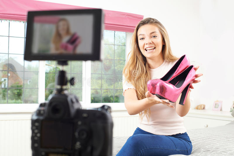 Female Vlogger Recording Broadcast In Bedroom. Female Vlogger Records Broadcast In Bedroom royalty free stock images