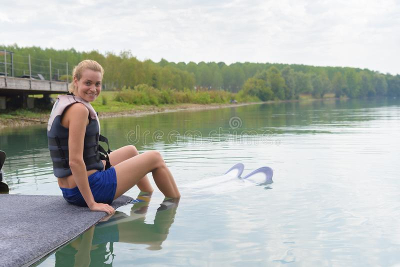 Female wakeboarder waiting to start seance royalty free stock photos