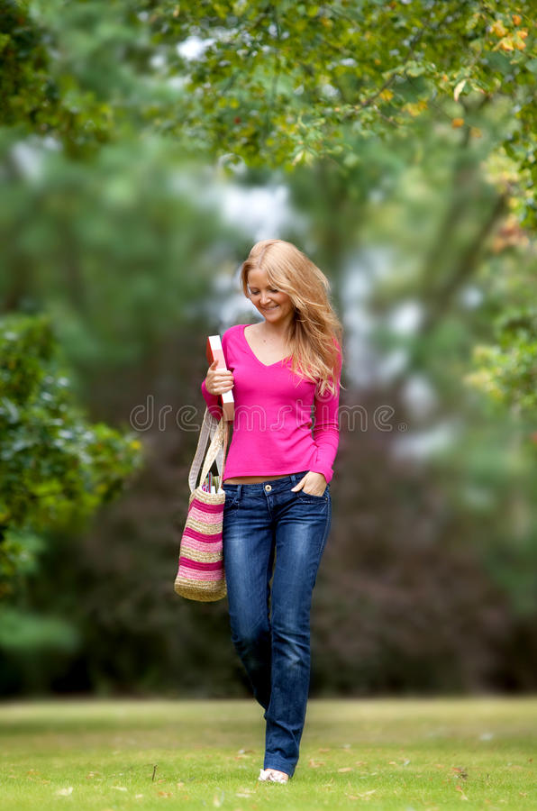 Download Female Walking Through Campus Stock Photo - Image of casual, smiling: 12086718