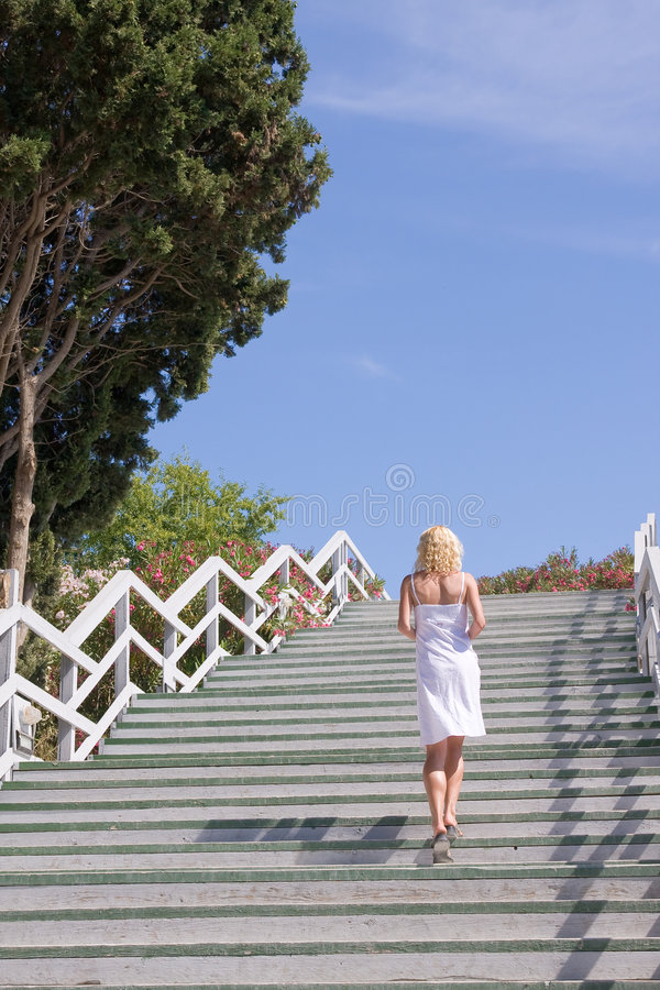 Download Female Walking Up The Stairs Stock Photo - Image: 5884554
