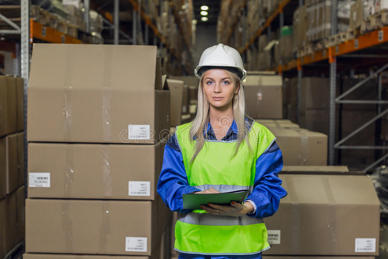 Female warehouse worker looking at camera royalty free stock photos