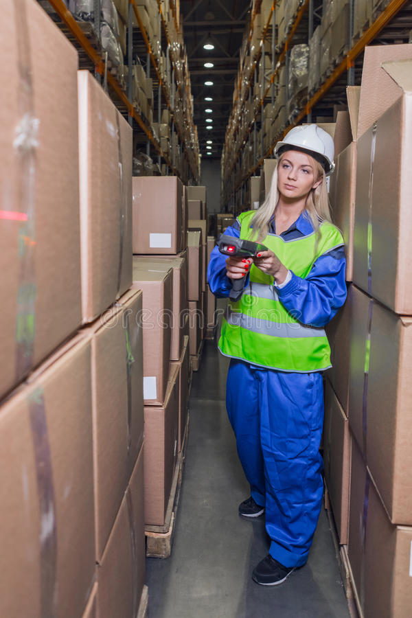Female warehouse worker using scanner in storehouse stock images