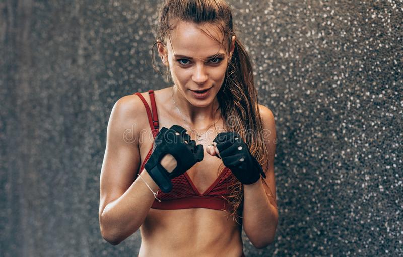 Female wearing gloves ready to fight stock image