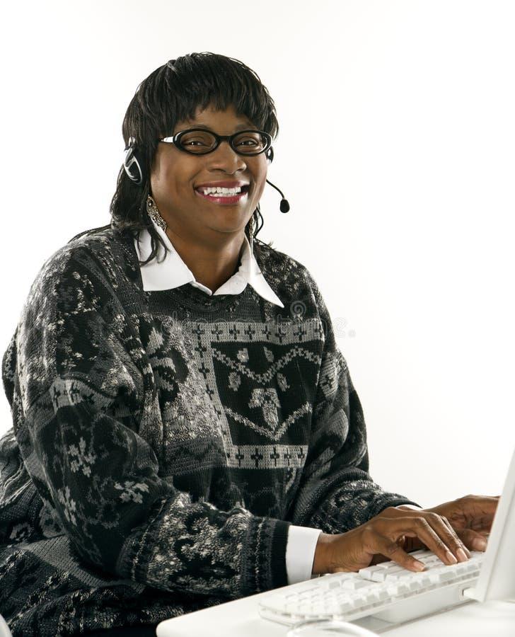 Female wearing headset stock photography