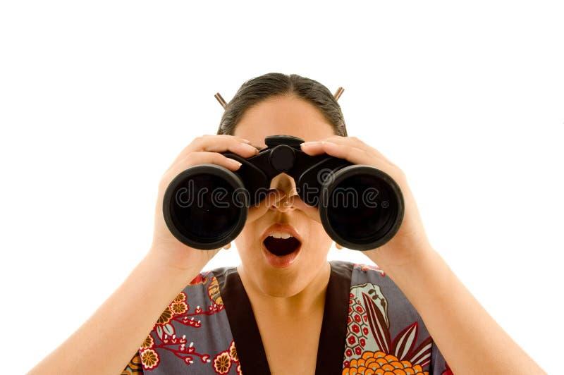 Female Wearing Kimono Viewing Through Binoculars Stock Photography