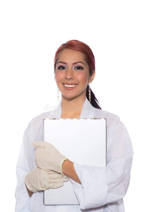 Female Wearing Lab Coat While Holding Clipboard stock image