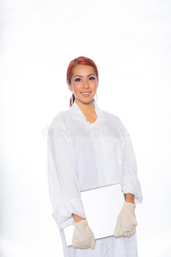Female Wearing Lab Coat While Holding Clipboard stock photo