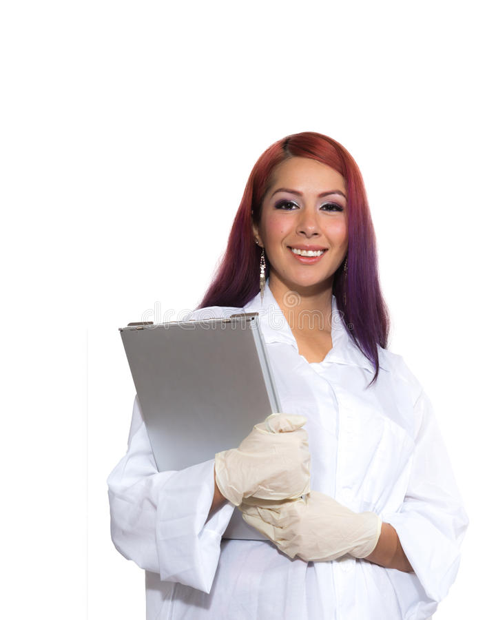 Female Wearing Lab Coat While Holding Clipboard royalty free stock photo