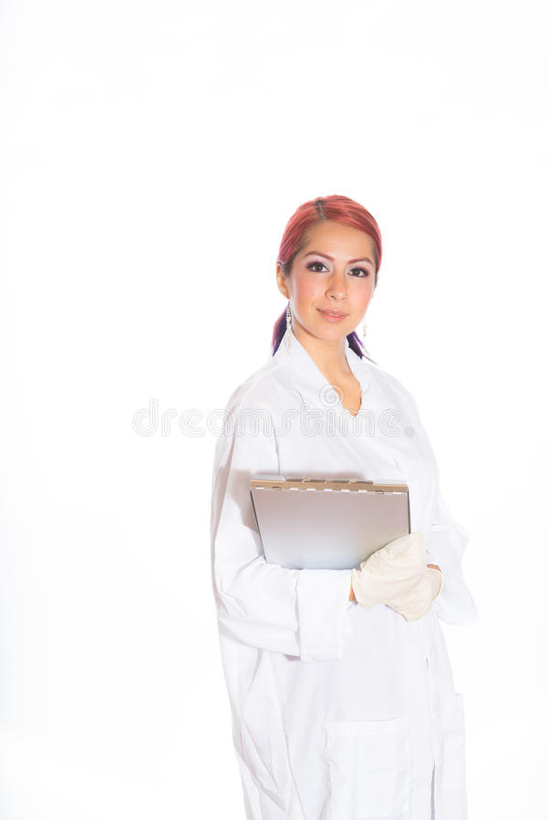 Female Wearing Lab Coat While Holding Clipboard stock photography