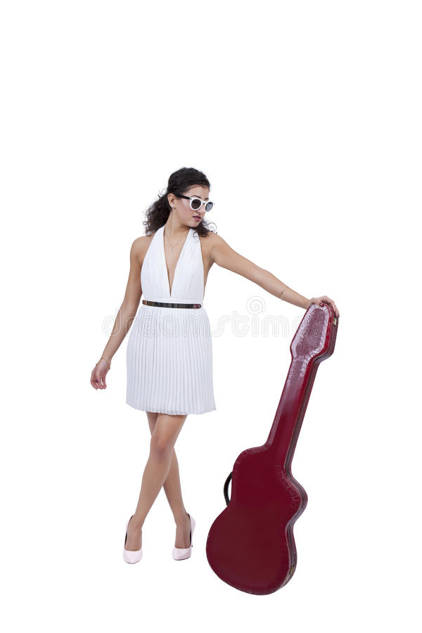 Female wearing sunglasses posing with guitar stock photo