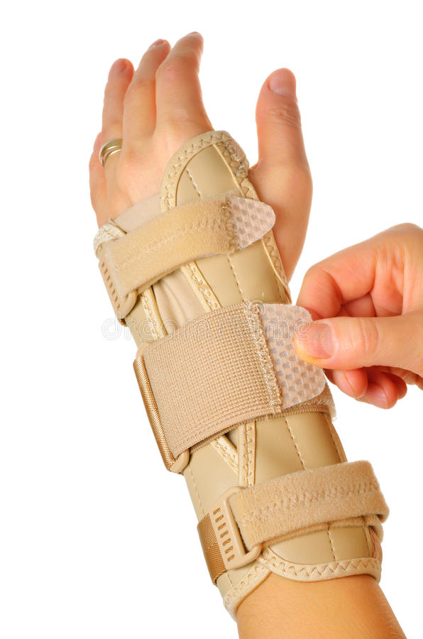 Female wearing wrist brace over white background. Velcro Straps on a Carpal Tunnel Support Wrist Brace stock photos