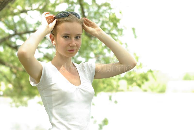 Female in a white royalty free stock photos