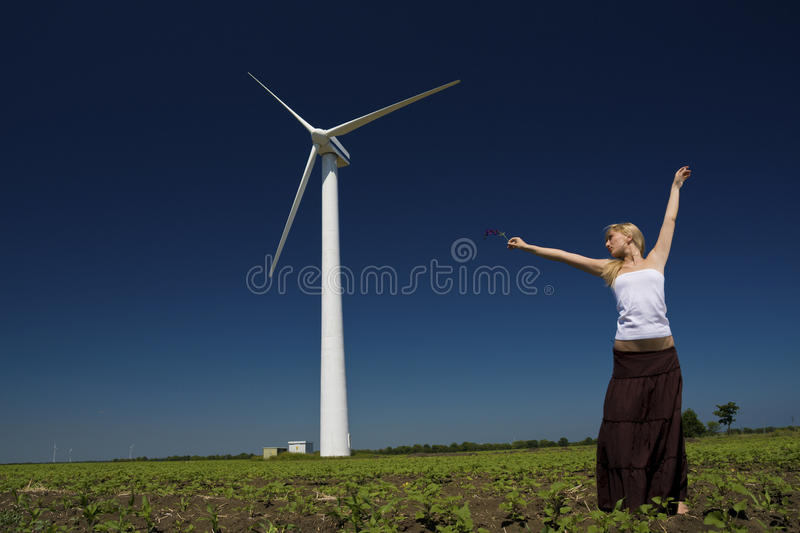 Female at wind power generator stock images