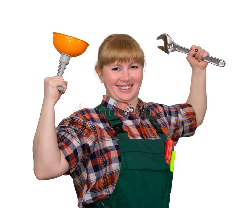 Female winner of the blockage in the pipe. Young woman with a small plunger and an adjustable wrench in a triumphant pose smiling isolated on a white background royalty free stock images