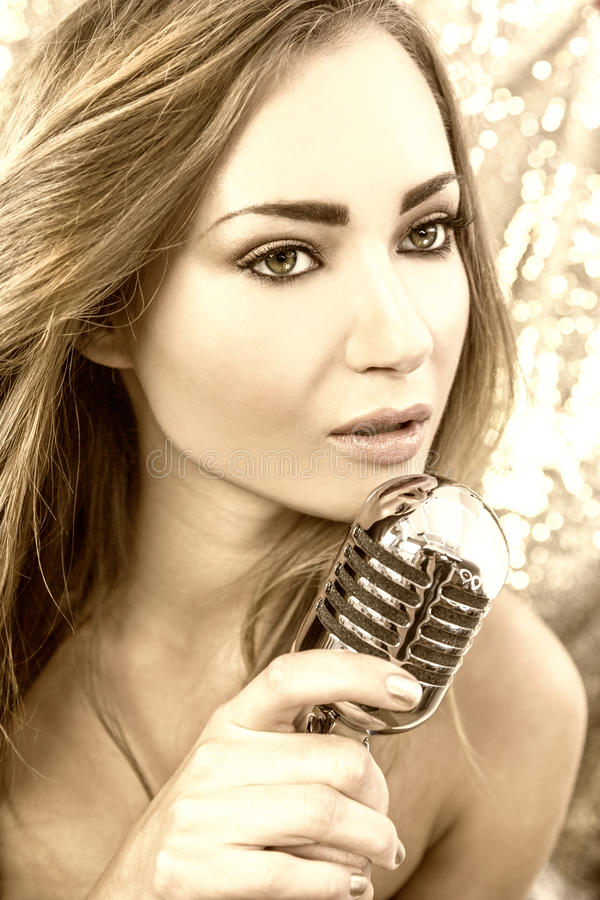 Female Woman Singing With Vintage Microphone stock images