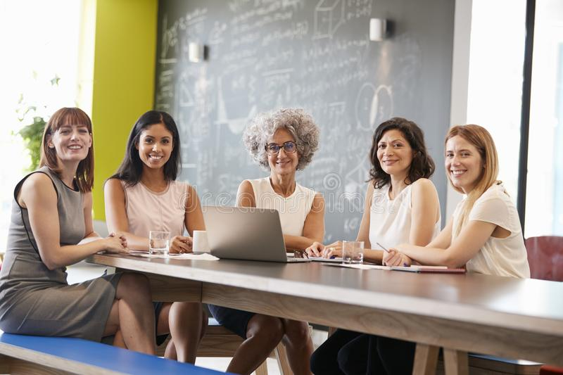 Female work colleagues at informal meeting looking to camera royalty free stock images