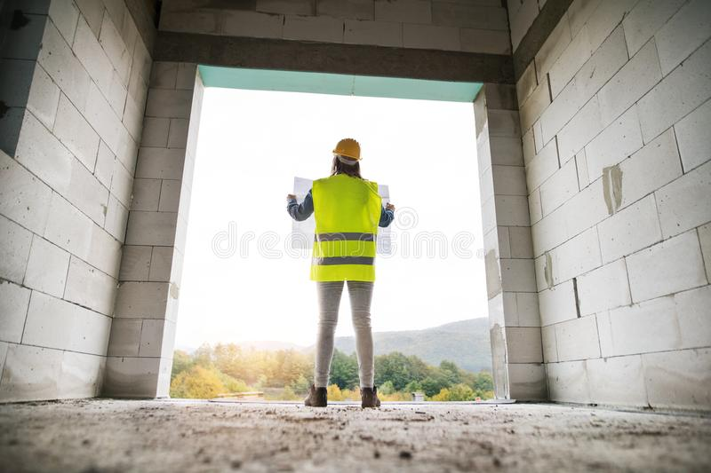 Young woman worker on the building site. royalty free stock photography