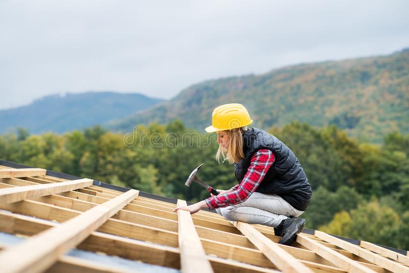 Young woman worker on the construction site. royalty free stock image