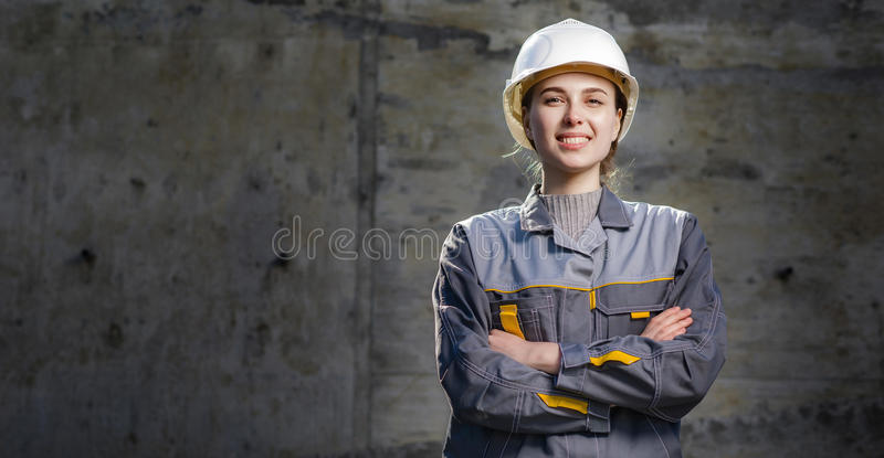 Female worker at a construction stock photography