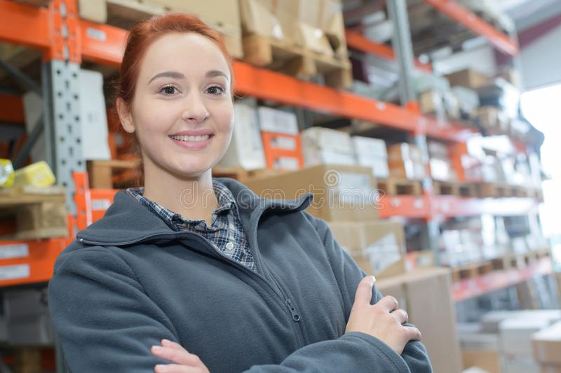 Female worker in distribution warehouse stock photography