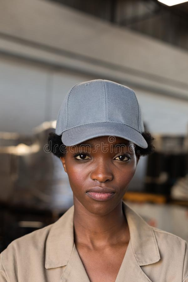 Female worker looking at camera in warehouse. Close-up of female worker looking at camera in warehouse. This is a freight transportation and distribution royalty free stock images