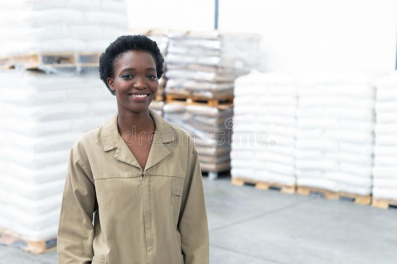 Female worker looking at camera in warehouse stock images