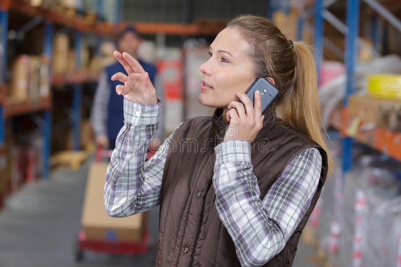 Female worker making cvall in distribution warehouse stock image