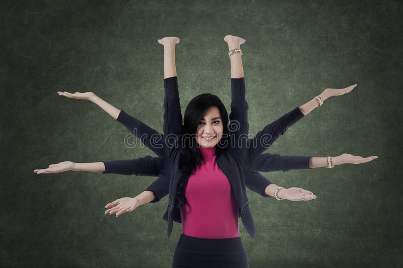 Female worker with multitasking hands royalty free stock photo