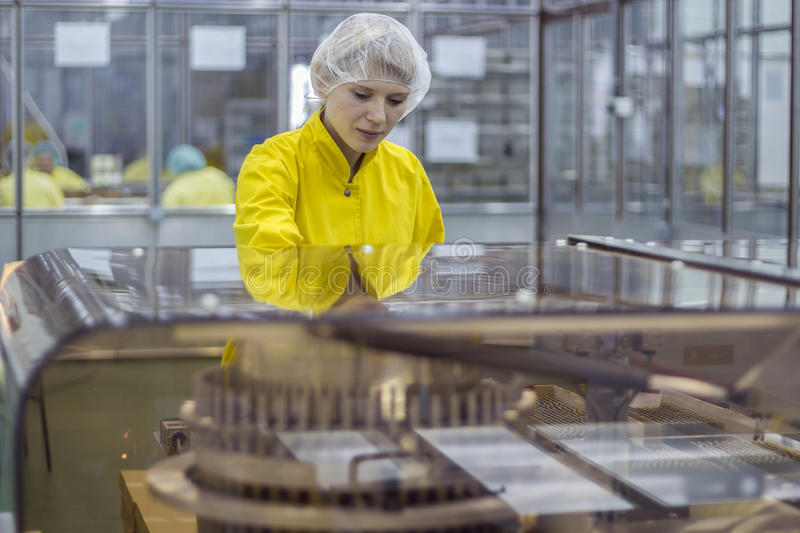 Female Worker At Pharmaceutical Factory stock image